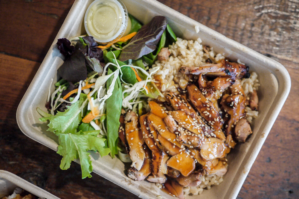 "Chicken Thigh Teriyaki with Brown Rice and Salad with Honey Lemon Dressing ($7.50).  Portion is super decent with generous chunks of quality cuts and perfectly cooked brown rice. You know how sometimes brown rice could be a bit tough compared to white rice, but here, they nailed it. Also, the honey lemon salad dressing has a strong hint of lemony sweet which I like. It complements the crisp and fresh veggies and balance the whole meal! This is what I call ""happiness in a recycled-paper box""."