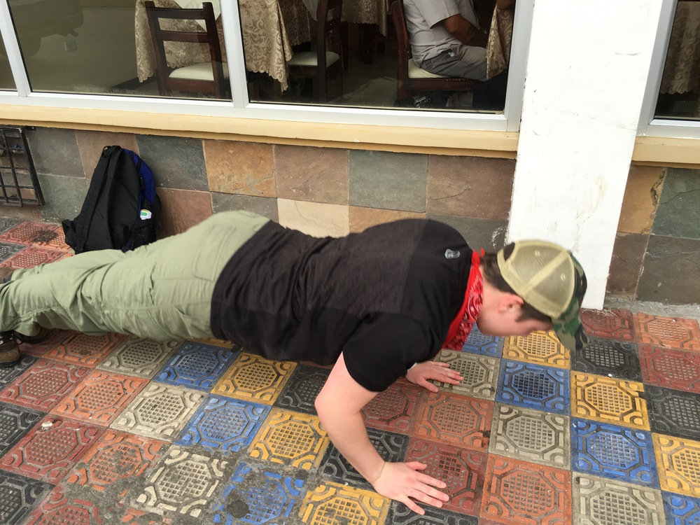 Unfortunatley the video I did of Adam doing the last five of 40 pushups was to large to load.  Here is a picture of him in from of our hotel showing off his form.