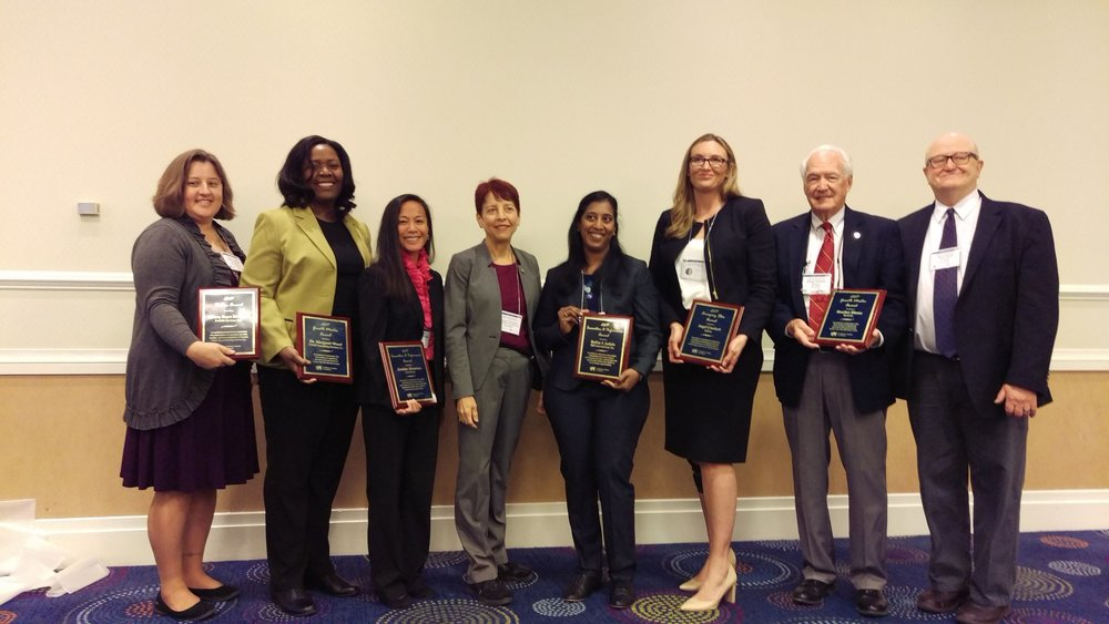 Angel Crockett stands with fellow USWCC awardees and Margot Dorfman, CEO of USWCC.