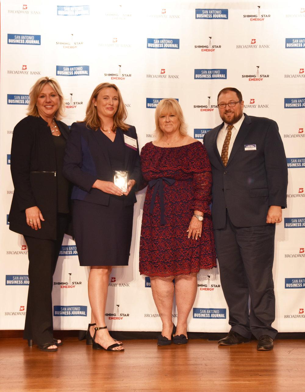 Angel Crockett receives her San Antonio Business Journal Women's Leadership Award as an Honoree.