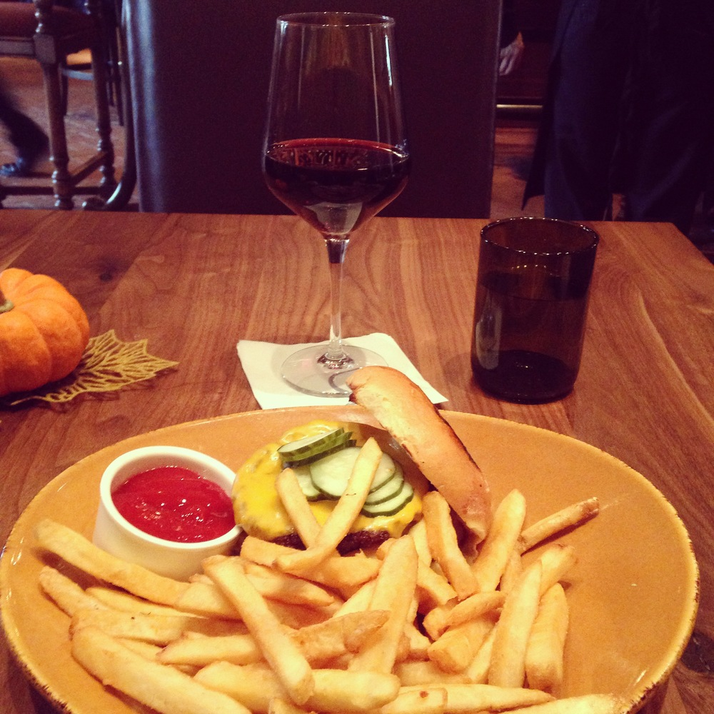 This may look like a glass of local wine and a burger and fries, but it was actually some of the best I've ever had. No joke!