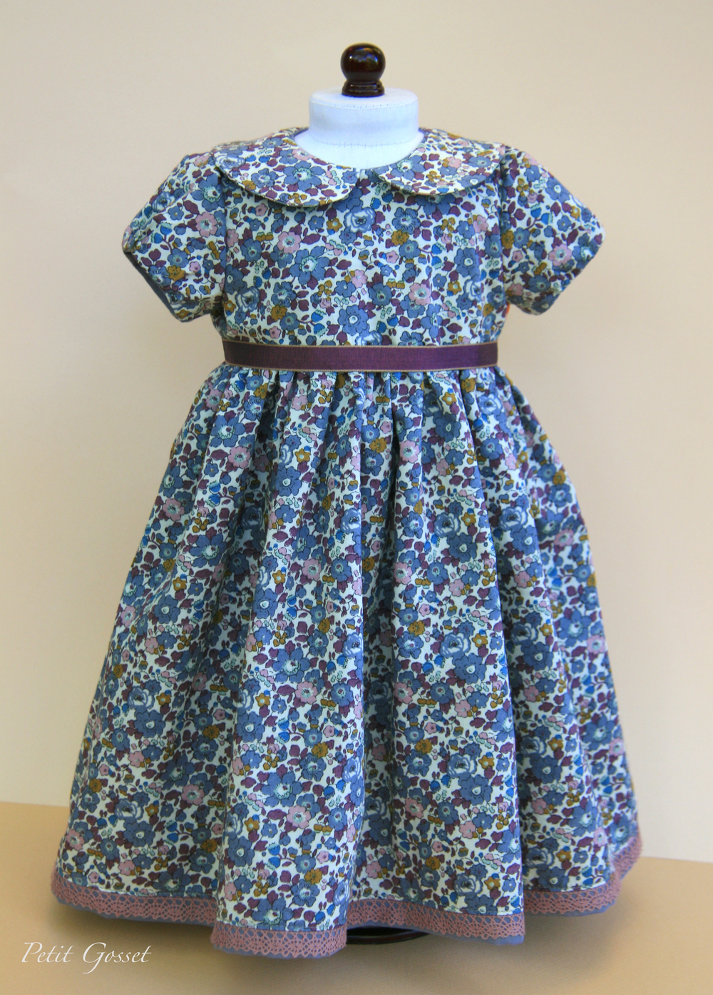 This beautiful floral dress is made with Liberty of London cotton lawn and fully lined with Swiss cotton voile. Opens in the back with nickel-free snaps.