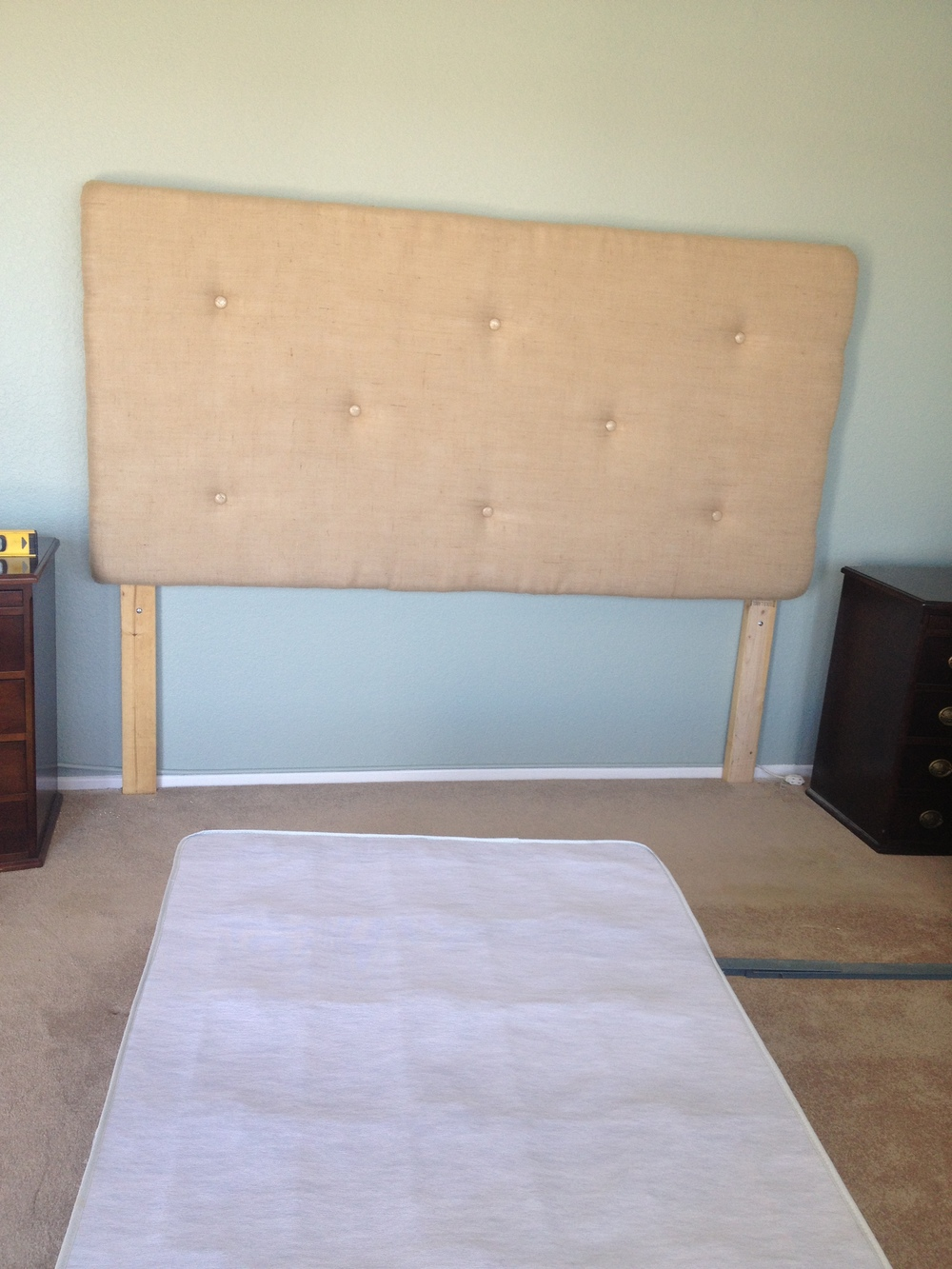 attached headboard to wall