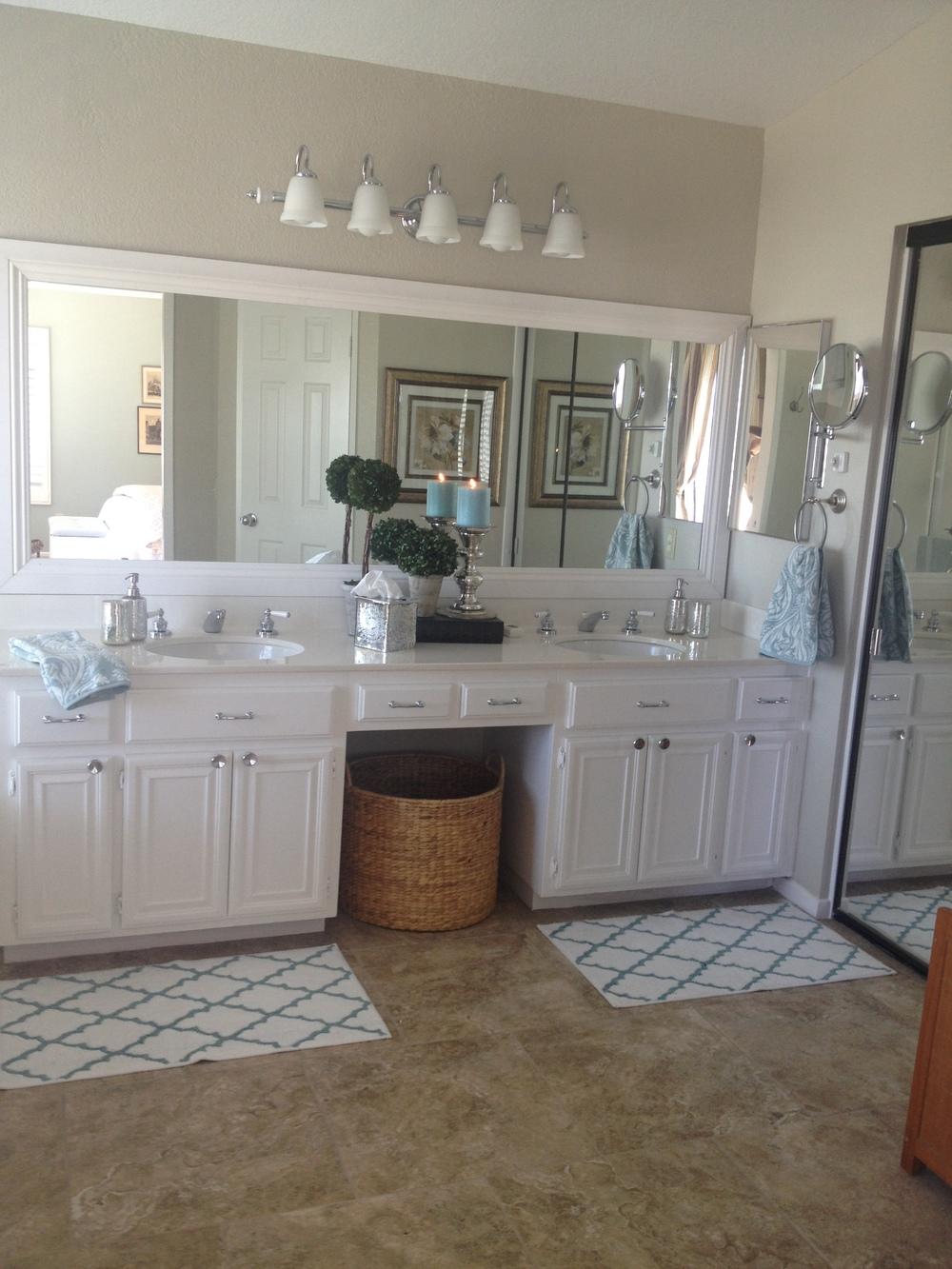 crisp , white , framed out non-boring bathroom mirror