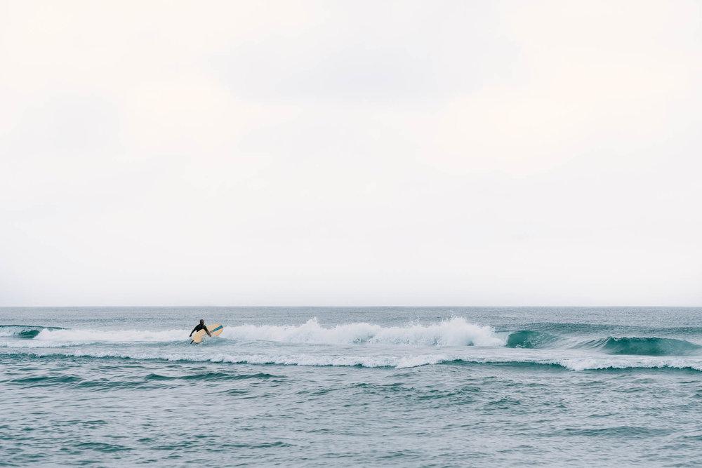 Surfer at Beach Haven Shore