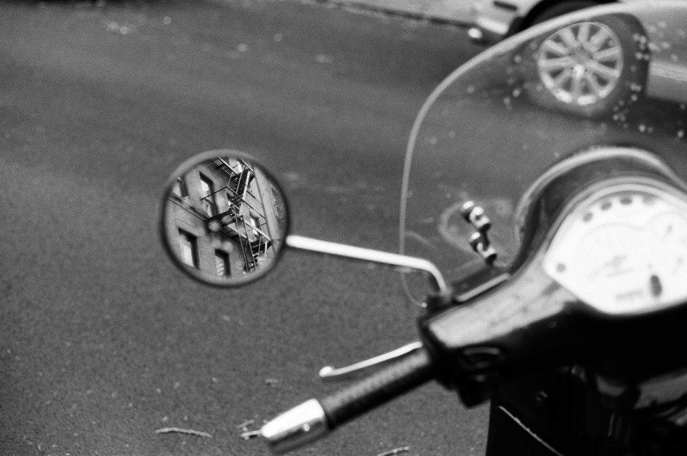 Buildings in Motorcycle Mirror