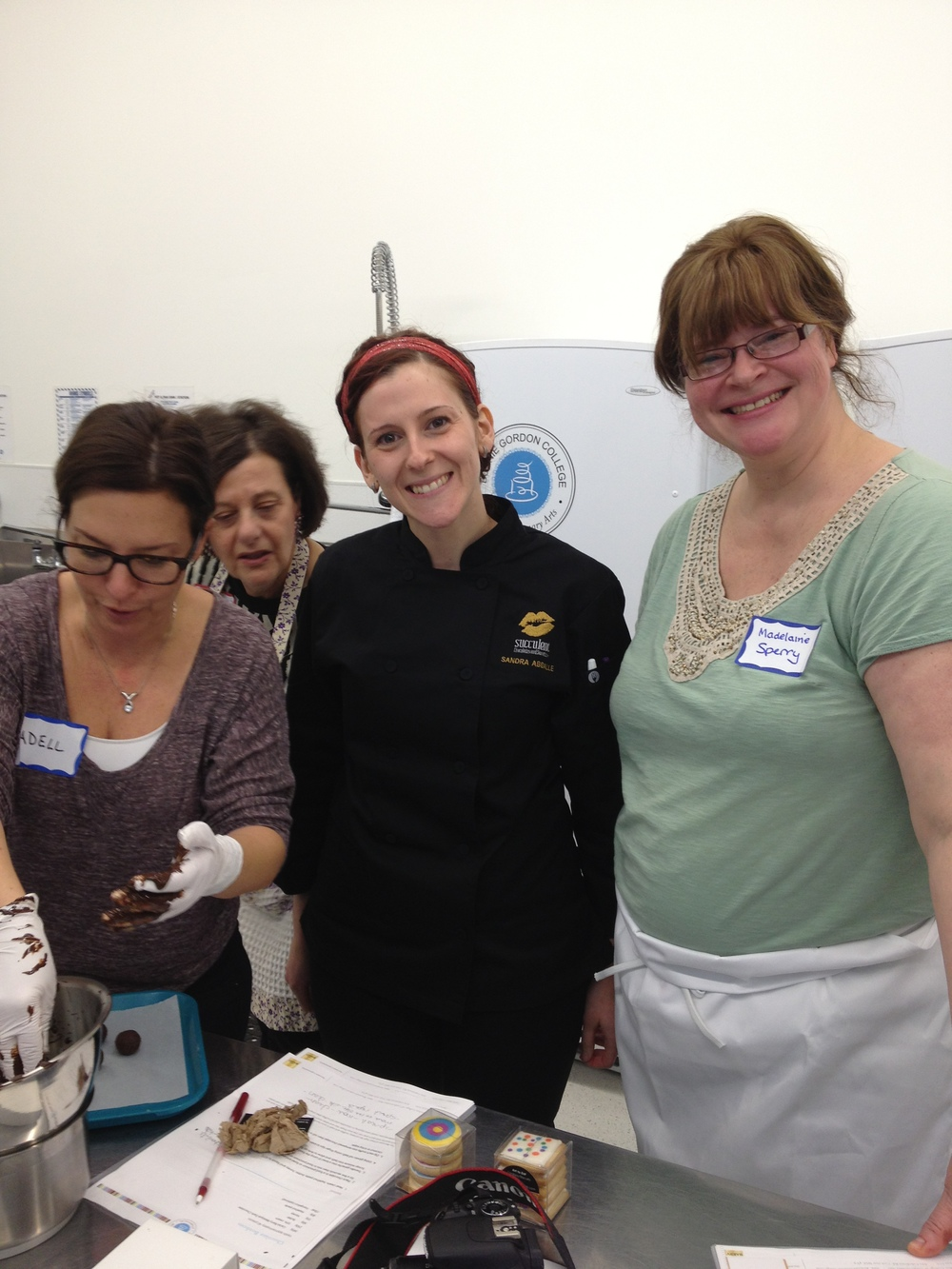Sandra working with some ladies of the Women's Culinary Network
