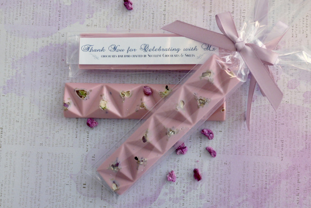 Our beautiful vintage rose chocolate bar is topped with crunchy pistachios, pomegranates and gold speckles