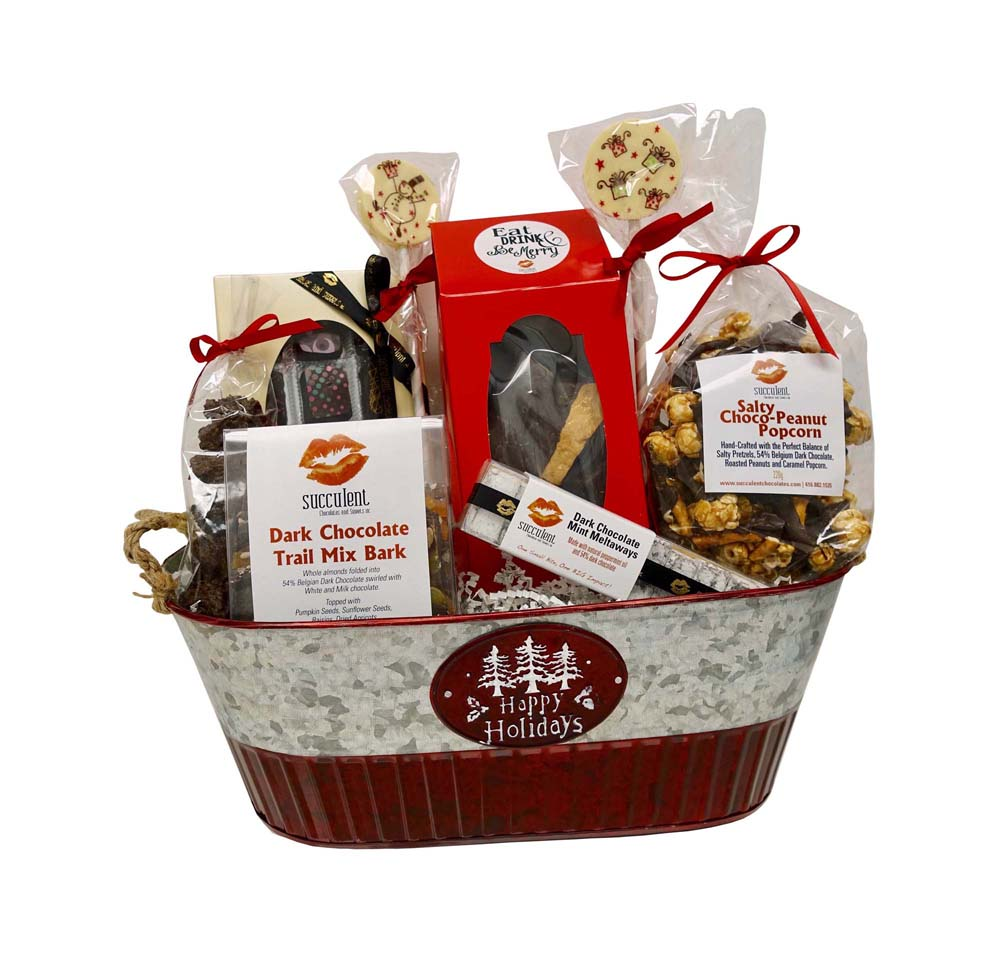 "Happy Holidays Basket - $95.00 H- 17"" W- 14.5"" D- 7"" This basket will transport you into a moment of bliss with a combination of our decadent hand crafted truf es and salty choco-peanut popcorn."