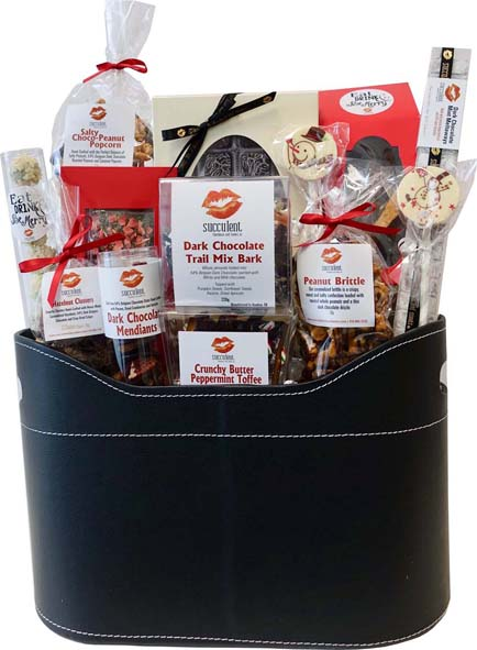 "Chocolate Deluxe Basket - 165.00 H- 19"" W- 15"" D- 6.25"" This collection of all hand crafted chocolates and confections will be sure to create the ulitmate chocolate experience for any client, friend or family member!"