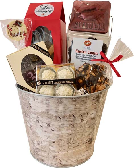 "Gourmet Delights Basket - 75.00 H- 16"" W- 9"" D- 9"" The pefect combination of our artisan chocolates including our truf es and peanut brittle."