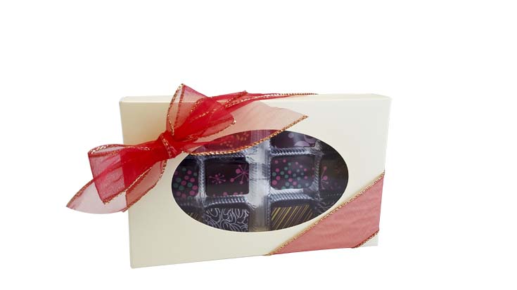 "Box of 12 Artisan Truffles- $18.00 1.5""H x 4.5"" W x 7.25"" L  Each truffle is hand-crafted with Belgian chocolate, natural flavours and coconut oil to ensure one small bite has a big impact."