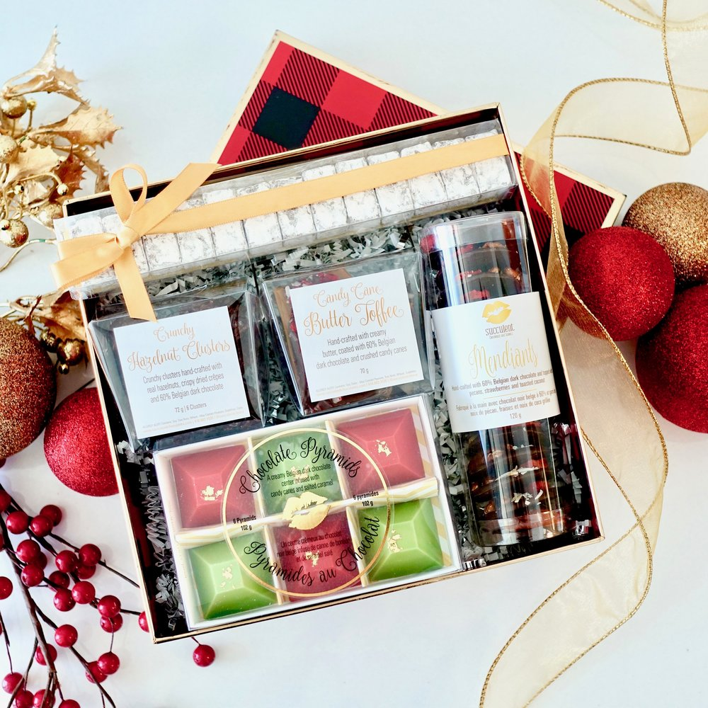 Perfect in Plaid  -  Just like the famous shirt, this cozy assortment of Succulent Chocolates confections is guaranteed to warm spirits.    $50.00