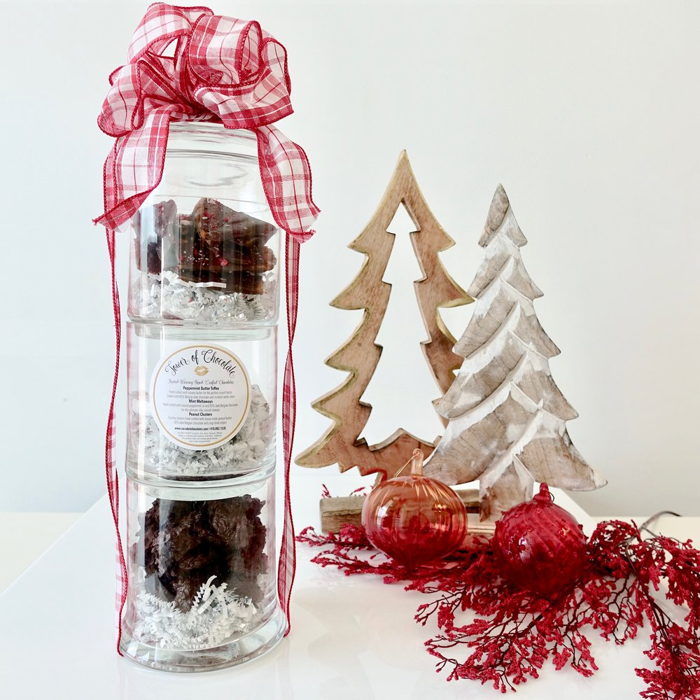 Tower of Chocolate  -  This glass   apothecary jar set is the perfect gift for there whole office to share. Filled with our hand crafted butter toffee, mint meltaways and dark chocolate peanut clusters.     $65.00