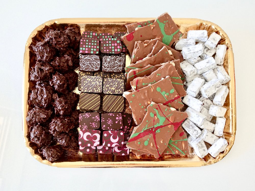 Chocolate Platter (LARGE)  -  A collection of hazelnut clusters, milk chocolate almond bark, assorted truffles and mint meltaways. Perfect to feed 14-25 people. Wrapped in a gift box and presented with a beautiful wired bow.  $75.00