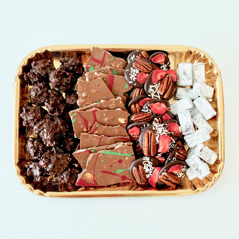 Chocolate Platter (MEDIUM)  -  A collection of hazelnut clusters, milk chocolate almond bark, mendiants and mint meltaways. Perfect to feed 8-12 people. Wrapped in a gift box and presented with a beautiful wired bow.  $45.00