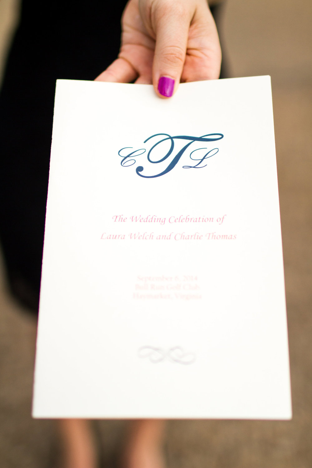 Navy and coral wedding program