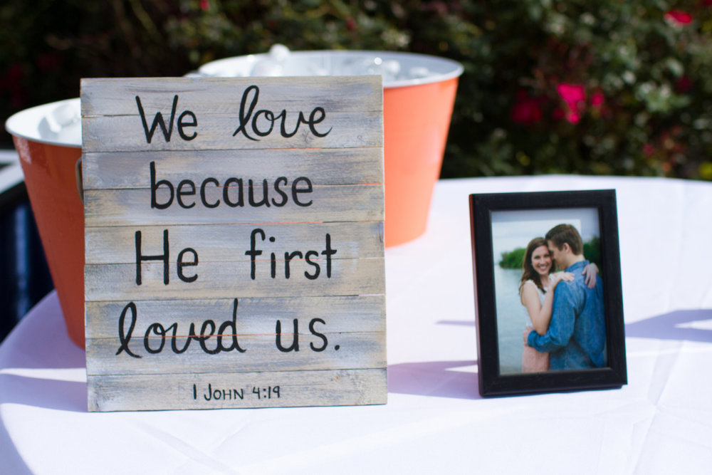 We love because He first loved us wedding sign