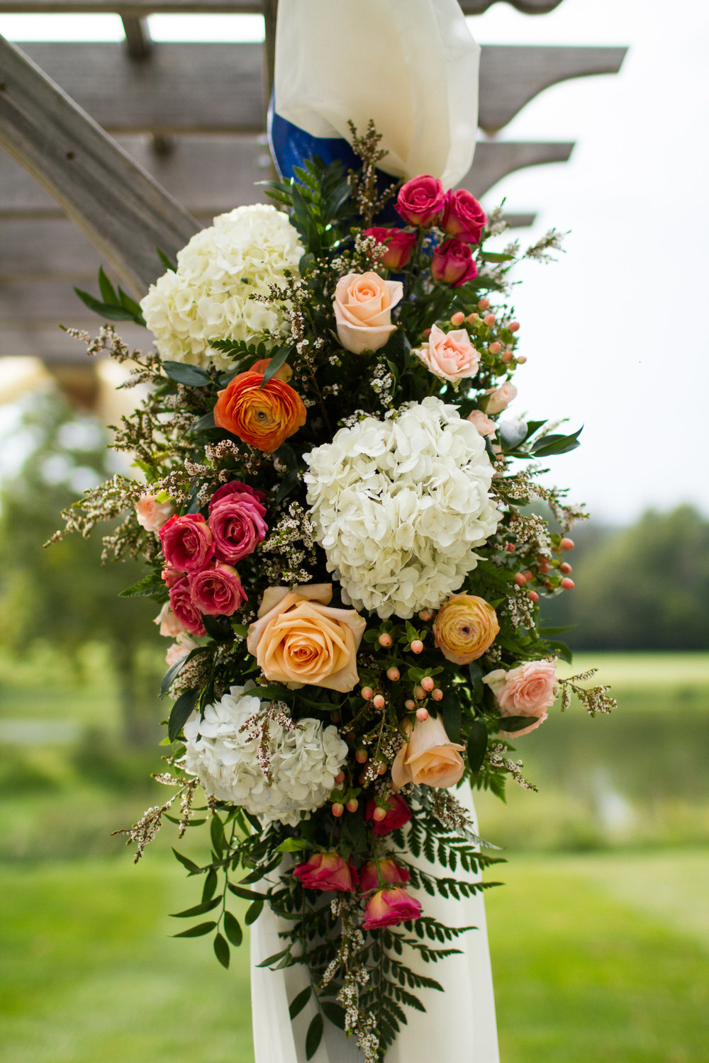 Gorgeous floral ceremony backdrop | Love is ... floral catering
