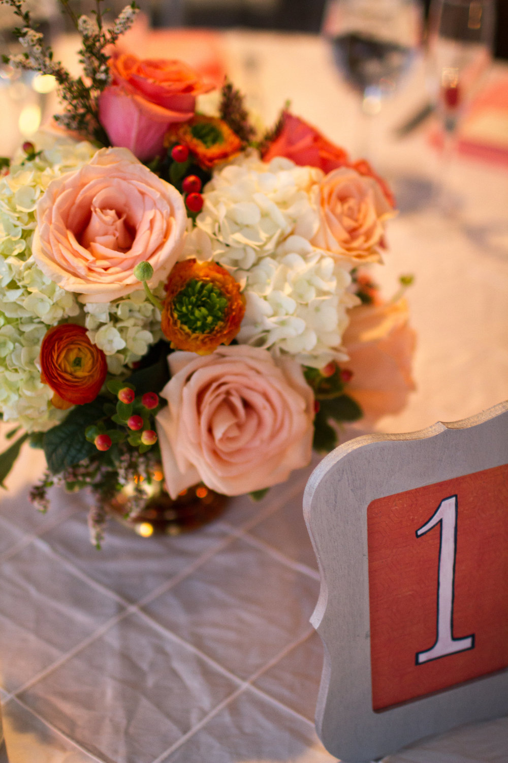 Love is ... Floral Catering | Coral wedding centerpiece