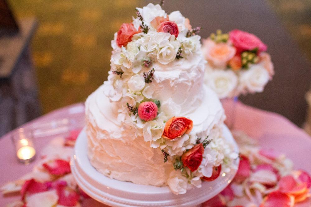 Beautiful white and coral wedding cake | Bull Run Golf Club