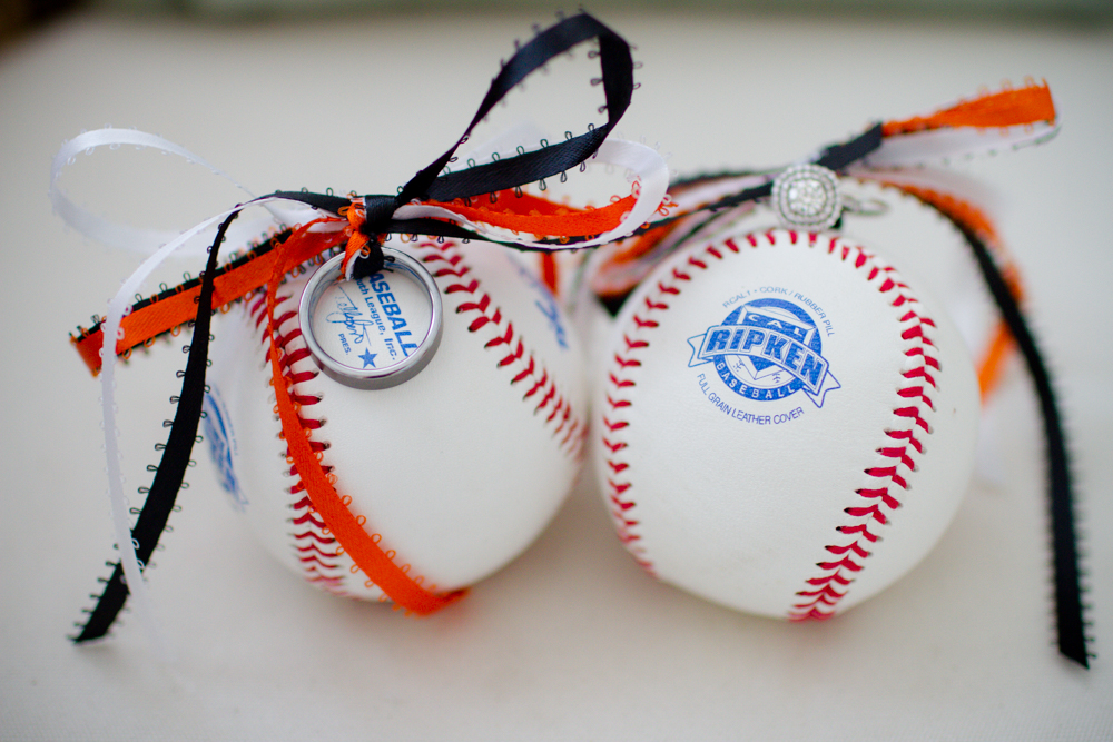 Wedding rings tied to a baseball