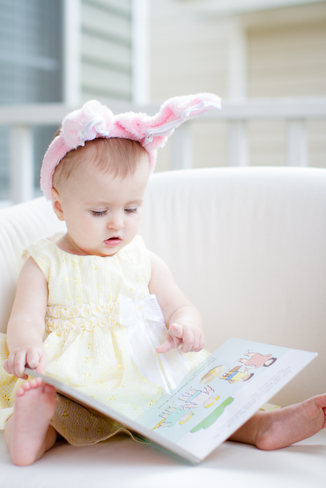 Baby reading book cute photo
