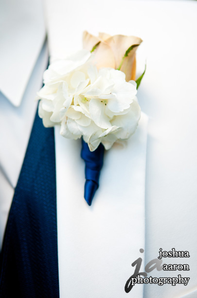 groom's white tuxedo and white Boutonnière