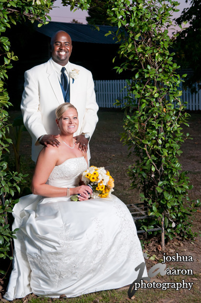 newly weds wedding photo outside under arbor at Corley Mill House & Garden lexington sc