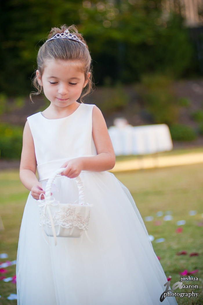 flower girl tossing flower petals