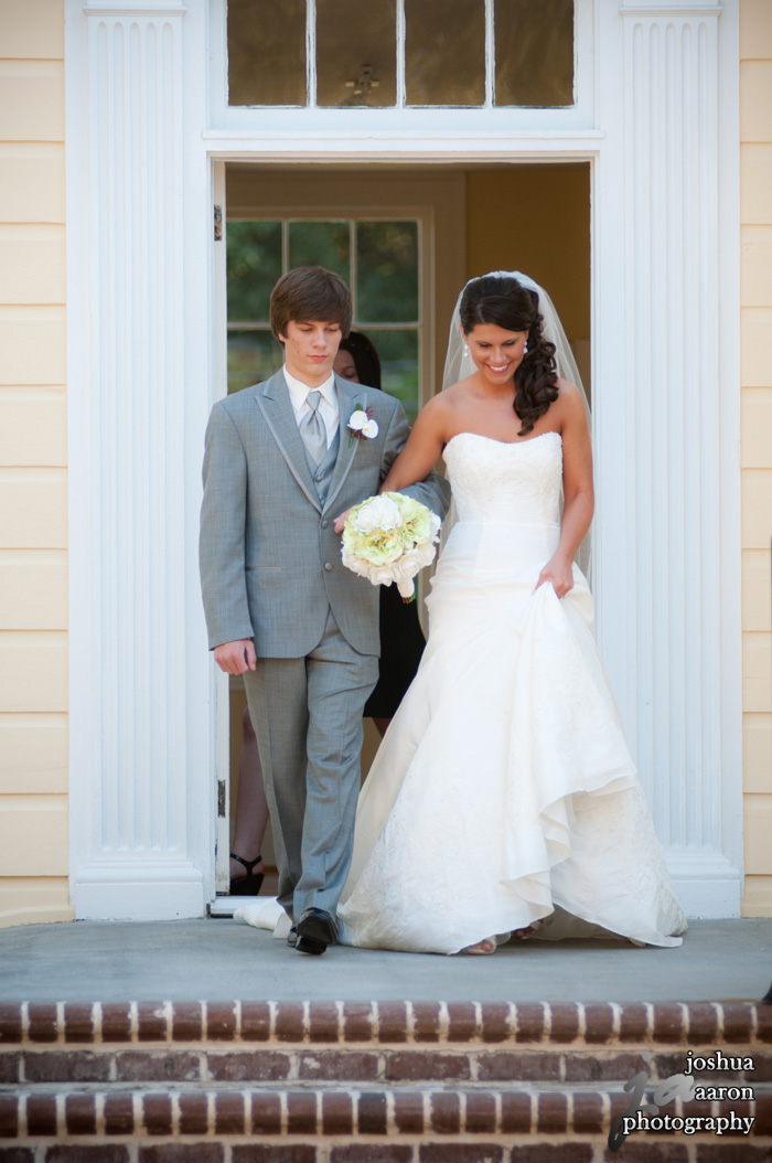 bride walking down steps to meet husband