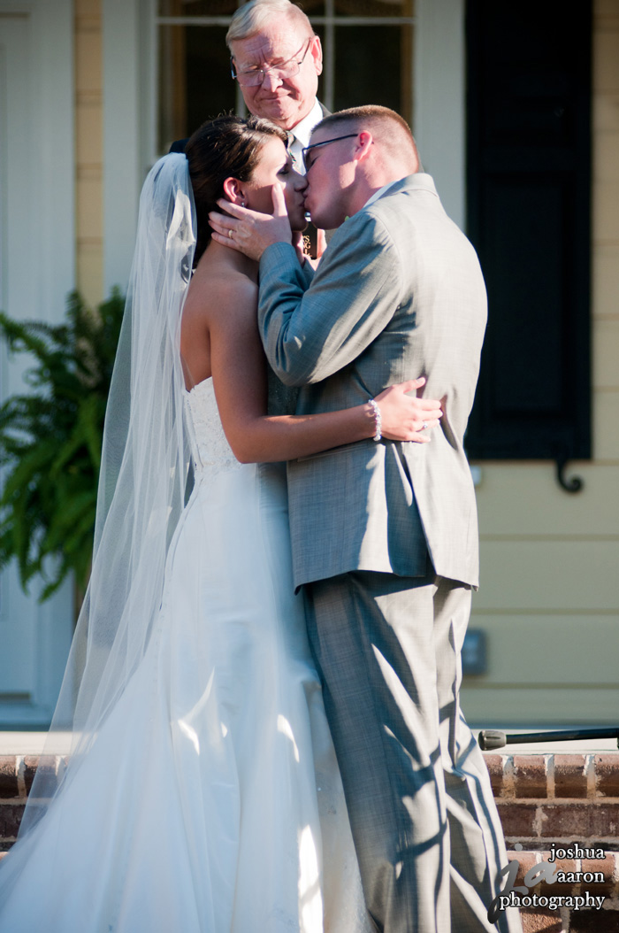 photo of couple's first kiss outside wedding at springdale house