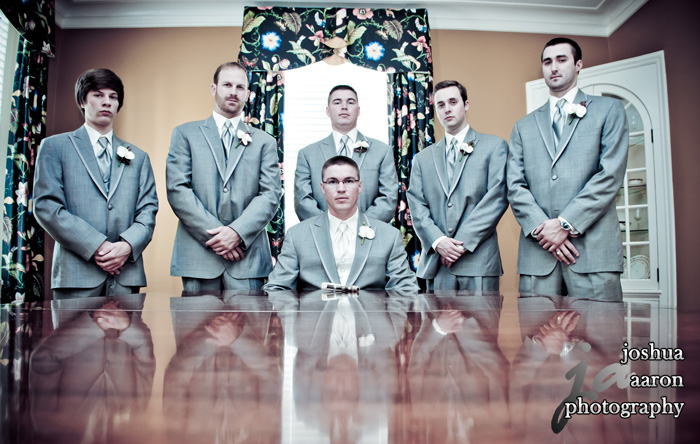 Groom and groomsmen looking serious in group photo