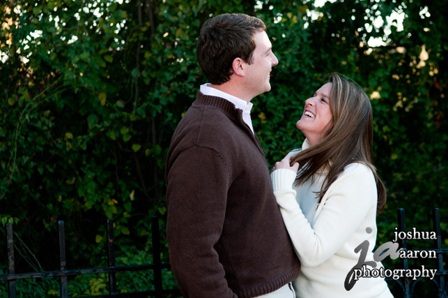 engagement photo at riverfront park columbia sc laughing