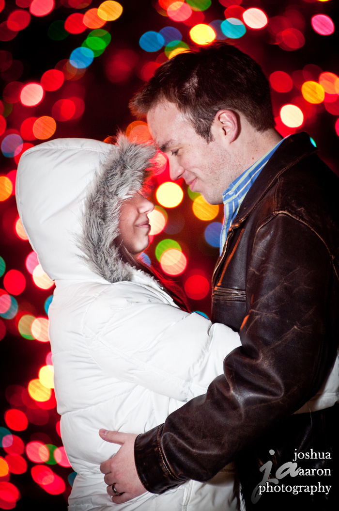 A little Christmas Magic engagement photo colorful lights cute couple
