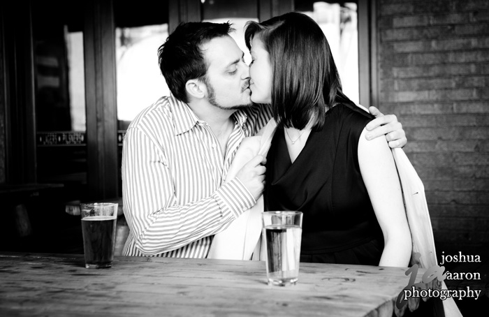 erin and ryan kiss at restaurant