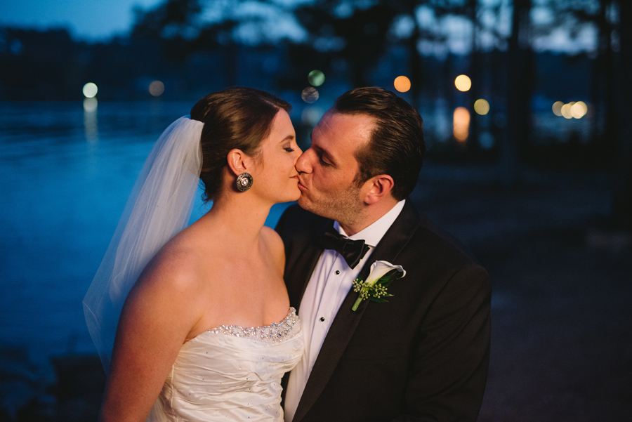 bride and groom evening kiss
