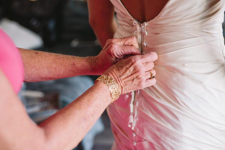 bride getting dress on