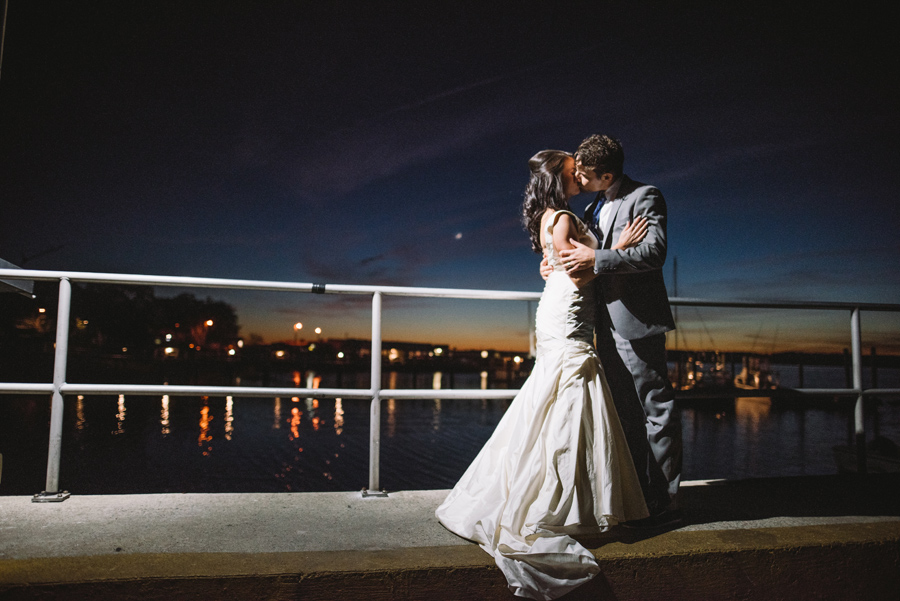 nighttime wedding portrait kiss