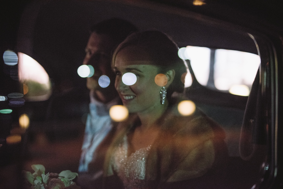 bride and groom city lights car