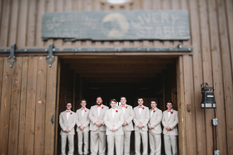 groomsmen in barn