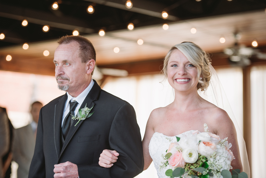 bride smiling ceremony