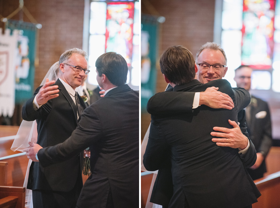 brides father hugs groom