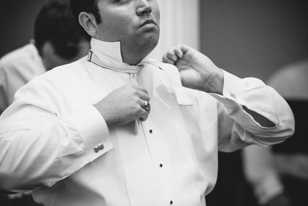 groom getting ready black and white