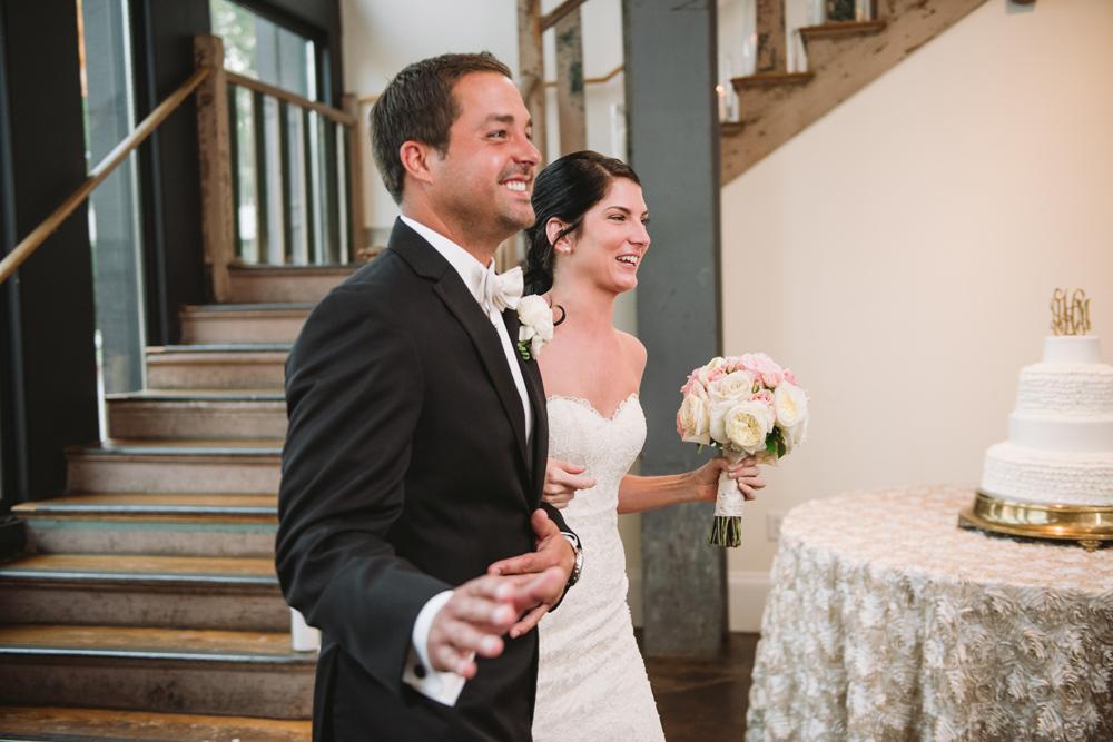 happy couple entering reception