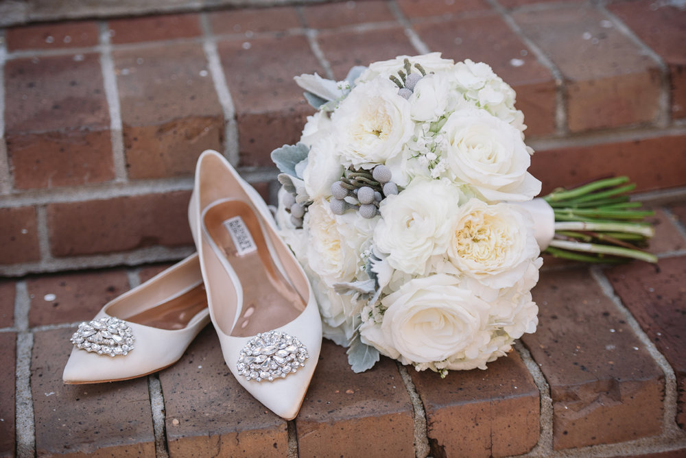 brides blush shoes and white bouquet
