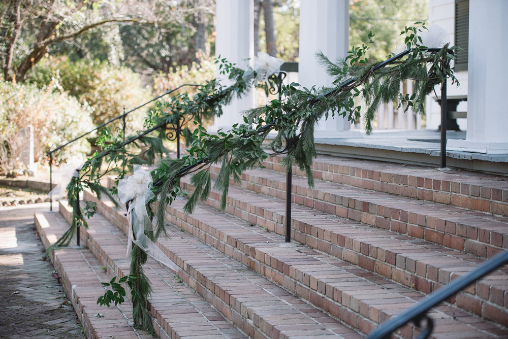 winter greenery on railing