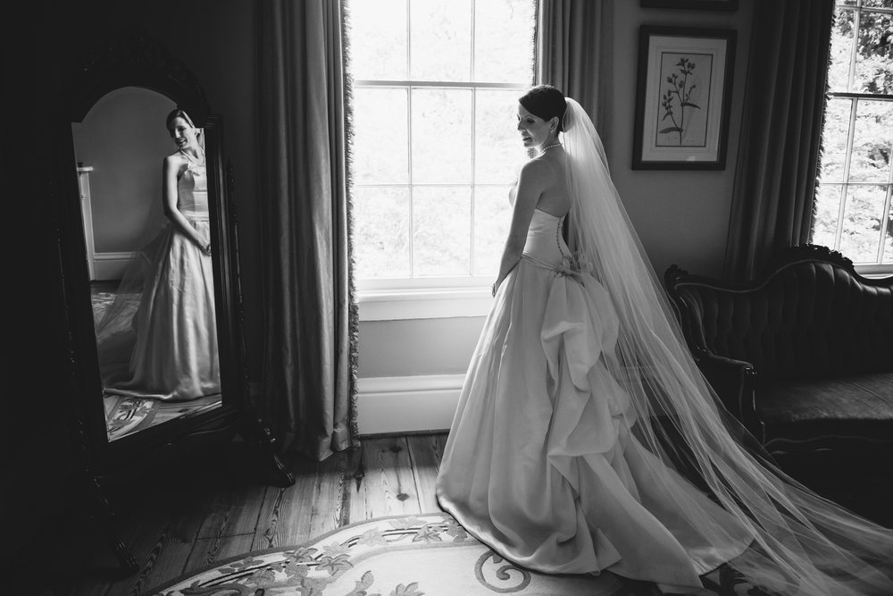 bride in front of mirror lace house