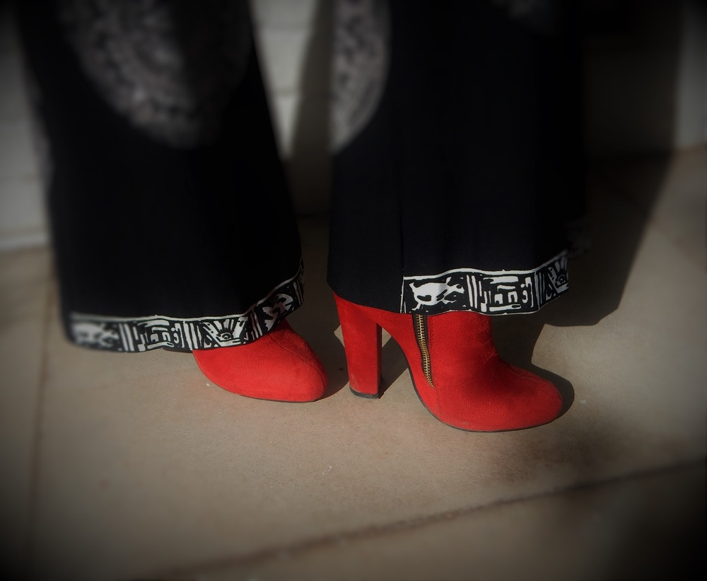 Image Credit: Idalia Alicea  Sydney's beloved red boots - the holy grail of any shoe collection.
