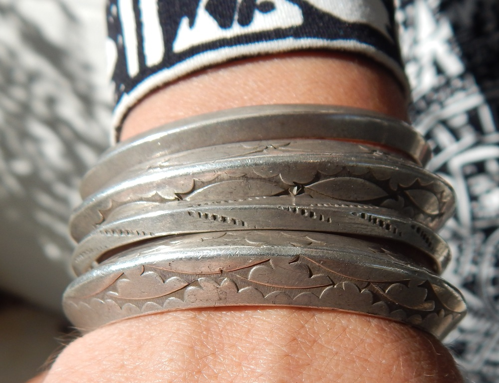 Image credit: Idalia Alicea  Sydney, daughter of funk musicians, showed up rocking these gorgeous silver bangles. The kicker - they were made BY HER DAD. Is it any wonder Sydney is the visual definition of style?